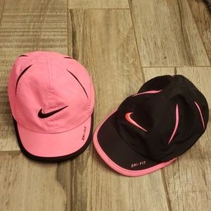 Two infant Nike hats/caps